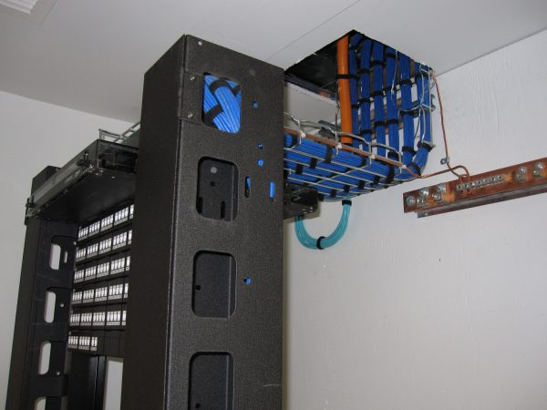Dressed blue cat6 from ceiling into server rack - Bluewire